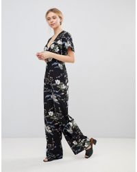 5aae4fc07915 Lyst - Girls On Film Floral Jumpsuit With Kimono Sleeves in Black