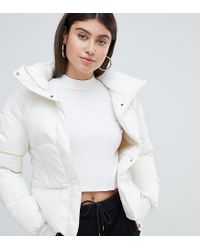 9c7e1979856e PUMA Down Filled Cream Jacket With Hood in White - Lyst