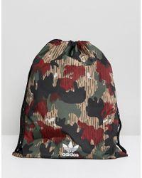 f5a5093be4 adidas Originals. Women s Originals X Pharrell Williams Hu Camo Drawstring  Bag