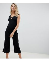 a03cf794d Boohoo Ribbed Culotte Jumpsuit in Black - Lyst