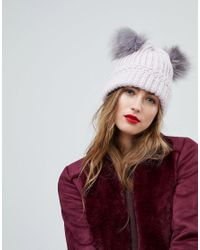 932411cad2c Lyst - River Island Faux Fur Double Pom Pom Beanie Hat in Purple