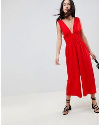 cfe00e2631d ASOS Ruched Waist Plunge Jumpsuit in Red - Lyst