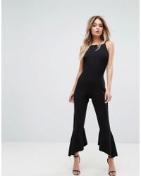 ec1a408716a8 Prettylittlething Frill Hem Jumpsuit in Black - Lyst