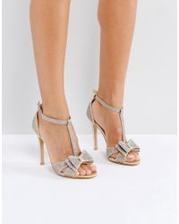 0038342922a True Decadence Gold Glitter Bow Heeled Sandals in Metallic - Lyst