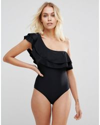 12188879db044 Warehouse Ruffle One Shoulder Swimsuit in Black - Lyst