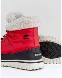 Sorel - Cozy Carnival Red Waterproof Flat Boots - Lyst