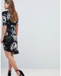 Yumi' - Black Floral Asymmetric Wrap Front Dress - Lyst