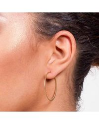 Dutch Basics | Yellow Fine Hoop Earrings | Lyst