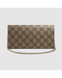 d7f7fc46b38 Lyst - Gucci Gg Supreme Chain Wallet in Natural