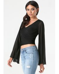 Bebe - Black Flare Sleeve Crop Sweater - Lyst
