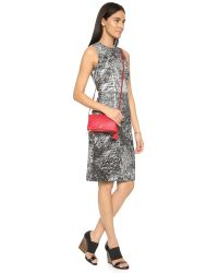 Tory Burch | Red Robinson Mini Fold Over Bag - Tiger's Eye | Lyst