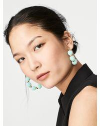 BaubleBar | Blue Havana Pom Pom Earrings | Lyst