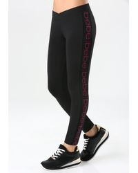 Bebe - Black Vertical Logo Leggings - Lyst