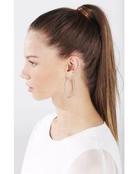 BCBGMAXAZRIA - Metallic Pave Oval Hoop Earrings - Lyst