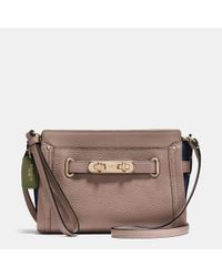 COACH | Natural Swagger Wristlet In Colorblock Pebble Leather | Lyst