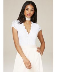 77a021e3a3b345 Bebe Lace Cap Sleeve Bodysuit in White - Lyst
