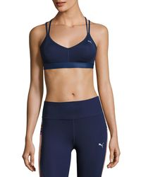 PUMA - Blue Yogini Low-impact Strappy Back Drycell Sports Bra - Lyst