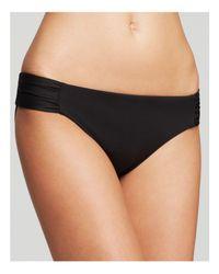 Becca | Black Color Code Shirred Tab Bikini Bottom | Lyst