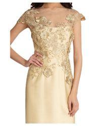 Teri Jon - Metallic Gold Lace Illusion Applique Cap Sleeve Column Evening Gown - Lyst