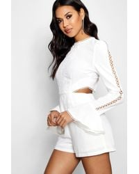 301d6832f1a Boohoo Boutique Cut Side Flare Sleeve Playsuit in White - Lyst