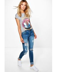 574c4c2c4891 Lyst - Boohoo Mid Rise Light Ripped Skinny Jeans in Blue