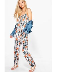 25c1fd9d0b Lyst - Boohoo Laura Strappy Floral Print Jumpsuit in Blue