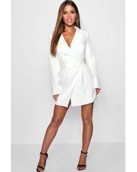 8c1b93819e72 Boohoo Petite Belted Asymmetric Blazer Dress in White - Lyst