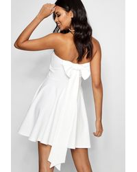 Boohoo Exaggerated Bow Back Skater Dress in White - Lyst 1d9176f6d