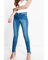 Boohoo - Nia Mid Rise Blue Wash Slit Knee Skinny Jeans - Lyst