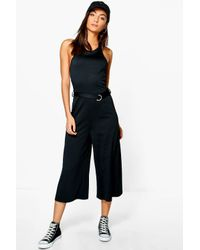 f82bf432346 Boohoo Tall Cherie Buckle Detail Culotte Jumpsuit in Black - Lyst