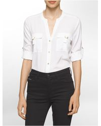 Calvin Klein | White Solid D-ring Roll-up Sleeve Top | Lyst
