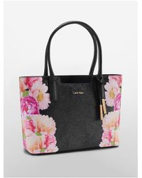 Calvin Klein | Black Floral Saffiano Leather Winged Tote | Lyst
