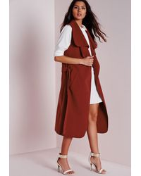 64fd1899ad8263 Missguided Sleeveless Belted Waterfall Coat Rust in Red - Lyst