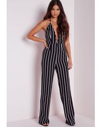 565444dc7b6e79 Lyst - Missguided Petite Striped Halterneck Wide Leg Jumpsuit Black ...