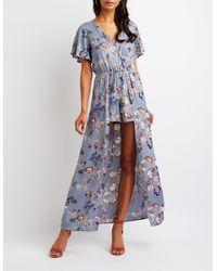 7f9f3f9a4401 Lyst - Charlotte Russe Floral Wrap Maxi Romper in Blue