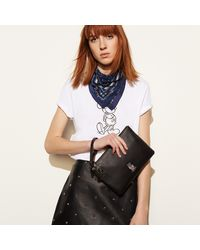 COACH - Black Mickey Turnlock Wristlet In Glovetanned Leather - Lyst