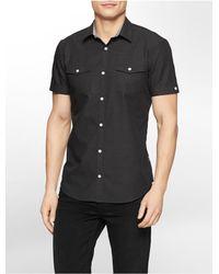3505e206d17 Calvin Klein. Men s Black White Label Slim Fit Birdseye Dobby Short Sleeve  Shirt