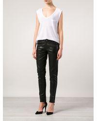 Balmain - Black Coated Skinny Mid-Rise Stretch-Denim Jeans - Lyst