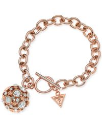 Guess | Pink Rose Gold-tone Fireball Peach Crystal Charm Bracelet | Lyst