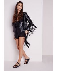 c7a2baa56db Missguided Black Wrap Frill Playsuit in Black - Lyst