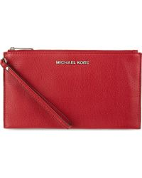 58aa173dd0f10 MICHAEL Michael Kors Bedford Large Zip Clutch Scarlet in Red - Lyst