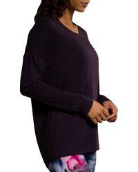 Onzie - Blue Dhalia Braid Back Long Sleeve Shirt - Lyst