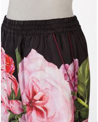 Dolce & Gabbana | Pink Floral-printed Silk Trousers | Lyst