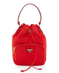 9a161b3c421d Lyst - Prada Tessuto Mini Bucket Crossbody Bag in Red