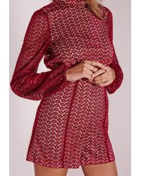 Missguided | Red Ladder Detail Lace High Neck Playsuit Oxblood | Lyst