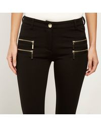 River Island - Black Ponte Double Zip Superskinny Trousers - Lyst