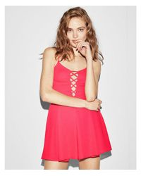 Express - Pink Lus Solid Lattice Front Romper - Lyst