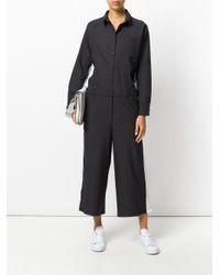 PUMA - Black Stripe Detail Jumpsuit - Lyst