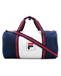 4d516a5ace Fila Logo Print Holdall Bag in Blue for Men - Lyst