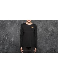 4c7667615 Lyst - Nike Sportswear Essential Metallic Longsleeve Top Black in Black